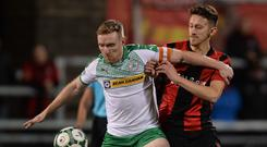 Noisy neighbours: Chris Curran and Jordan Forsythe battle it out in the last north Belfast derby