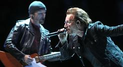 Bono and The Edge on stage (Andrew Matthews/PA)