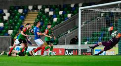 Final say: Andy Waterworth grabs the decisive goal for Linfield in extra-time
