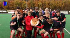 Newtown School get their hands on the Tasmanian Trophy for the first time.
