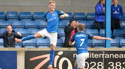 Jumping for joy: Mark Sykes celebrates yet another goal helping fire his side to the top