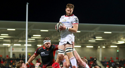 Dragons downed: Iain Henderson claims a line out