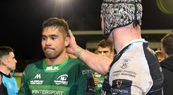 All over: Connacht's Jarrad Butler is consoled by Dan Lydiate after last night's game