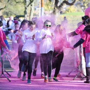 In the pink – runners got a dusting of bright pink powder at Cancer Focus NI's fun-filled family 5k Pink Run (Sunday) at Victoria Park in east Belfast. Photo by Kelvin Boyes / Press Eye.