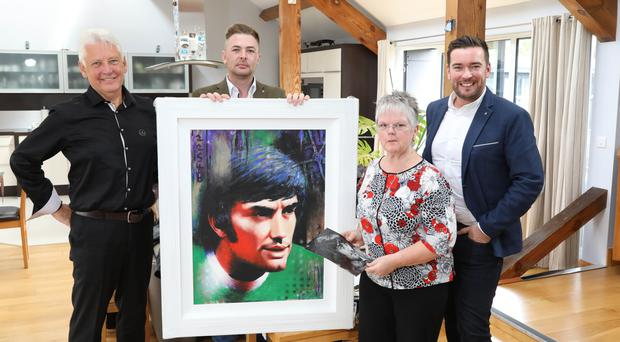 George Best's sister Barbara McNarry with her husband Norman (left), Gareth Milligan, director of sales George Best Hotel and Damian Gilvary, the hotel's general manager (right)