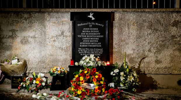 Flowers laid at the memorial site of the Greysteel massacre