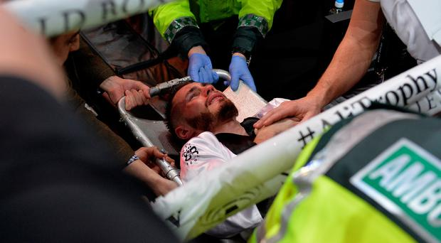 Ryan Burnett leaves the ring on a stretcher after he retired with an injury in his world title fight against Nonito Donaire.