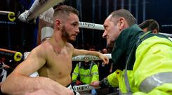 Ryan Burnett left the ring on a stretcher after he retired with an injury in his world title fight against Nonito Donaire.