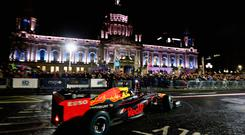 David Coulthard drives the double championship-winning RB8 during the Red Bull Racing Show Run on November 03, 2018 in Belfast, Northern Ireland. (Photo by Matthew Lewis/Getty Images for Red Bull Racing)