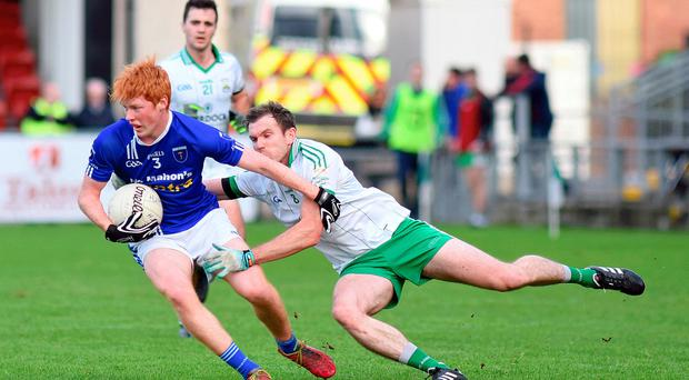 Close encounter: Scotstown's Ryan O'Toole is challenged by Declan Rooney of Burren