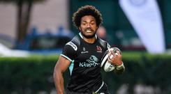 On the charge: Henry Speight makes a break for Ulster in Treviso