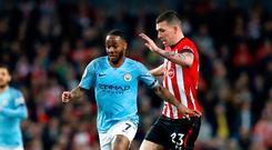 Winging it: Manchester City's Raheem Sterling (left) skips past Southampton's Pierre-Emile Hojbjergthen