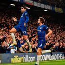 Jump to it: Chelsea's Spanish striker Alvaro Morata celebrates with team-mate Marcos Alonso