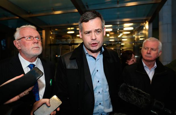 Sinn Fein TDs (left to right) Martin Ferris, Pearse Doherty and Sean Crowe outside the court in Dublin where John Downey appeared in relation to the murder of two Ulster Defence Regiment (UDR) soldiers in 1972. Photo credit: Niall Carson/PA Wire.