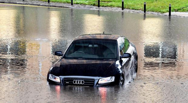 A car lies abandoned under the railway bridge at Laganbank Road in Belfast after serious flooding. Pic Alan Lewis Photopress
