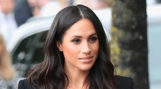 Star attraction: Meghan Markle in a suit