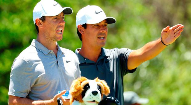 High hopes: Rory McIlroy pictured with caddie Harry Diamond ahead of the Nedbank Golf Challenge