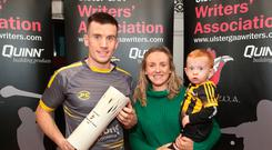 Winning ways: Ballycran's James Coyle, partner Jenni and son Cian with his Writers' award