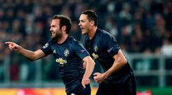Mat finish: Juan Mata celebrates his United equaliser with Nemanja Matic in Turin last night