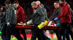 Sad sight: Arsenal's Danny Welbeck is carried off on a stretcher in the 0-0 draw with Sporting Lisbon at the Emirates last night