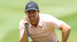 Green for go: Rory McIlroy on the third green in Sun City yesterday