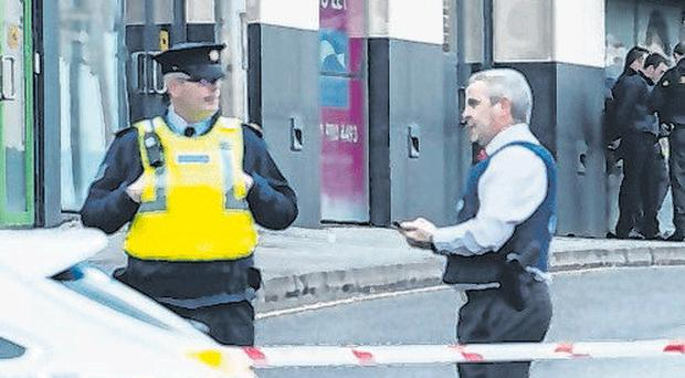 Gardai at the scene of yesterday's explosion in Drogheda where a pipe bomb device was used to target car of mobster's girlfriend