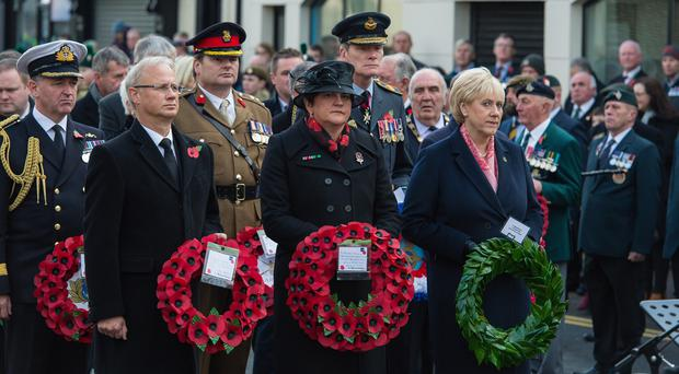 DUP leader Arlene Foster and Fine Gael TD Heather Humphreys pay their respects at the Enniskillen Cenotaph on Remembrance Sunday. Picture: Ronan McGrade Pacemaker