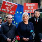 Anti-brexit protesters stands behind as Green Party of Northern Ireland leader Steven Agnew (L), Sinn Fein vice-president Michelle O'Neill (C), and SDLP leader Colum Eastwood (R), make statements in central London on November 12, 2018. (Photo by Daniel LEAL-OLIVAS / AFP)DANIEL LEAL-OLIVAS/AFP/Getty Images