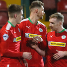 Red alert: Ryan Curran (second from left) celebrates his goal with Cliftonville team-mates Rory Donnelly, Gary Breen, Chris Curran and Joe Gormley