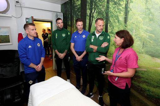 Press Eye - Belfast - Northern Ireland - 12th November 2018 - Photo by William Cherry/Presseye Players from Northern Ireland and Republic of Ireland in joint hospital visit Northern Ireland's Steven Davis and Jonny Evans with Republic of Ireland's Shane Duffy and David Meyler visited Olive O'Neill at Ireland's largest paediatric hospital, Our Lady's Children's Hospital Crumlin, to encourage young people who have cancer and to highlight the work of medical and caring staff who help to fight the disease.