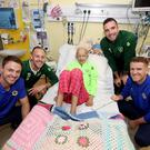 Players from Northern Ireland and Republic of Ireland in joint hospital visit. Northern Ireland's Steven Davis and Jonny Evans with Republic of Ireland's Shane Duffy and David Meyler visited 13-year old Freya Fitzpatrick at Ireland's largest paediatric hospital, Our Lady's Children's Hospital Crumlin, to encourage young people who have cancer and to highlight the work of medical and caring staff who help to fight the disease. Pic Presseye