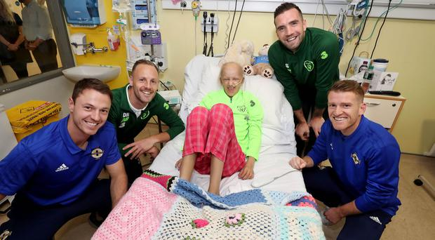 Press Eye - Belfast - Northern Ireland - 12th November 2018 - Photo by William Cherry/Presseye Players from Northern Ireland and Republic of Ireland in joint hospital visit Northern Ireland's Steven Davis and Jonny Evans with Republic of Ireland's Shane Duffy and David Meyler visited 13-year old Freya Fitzpatrick at Ireland's largest paediatric hospital, Our Lady's Children's Hospital Crumlin, to encourage young people who have cancer and to highlight the work of medical and caring staff who help to fight the disease.