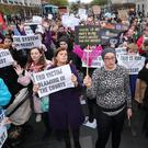 People gather for a protest in support of victims of Sexual violence in Dublin (Niall Carson/PA)