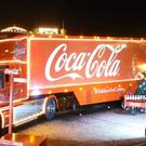 The two 14-tonne lorries decorated with fairy lights and offering free 150ml cans of Coca-Cola, Zero Sugar and Diet Coke have been welcomed by councils and shopping centres since 1995 (stock picture)