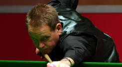 Table topper: Joe Swail on the way to victory over Nigel Bond at the Waterfront yesterday