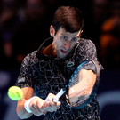 Fire power: World number one Novak Djokovic keeps his eye on the ball during his ATP Finals defeat of Russian Alexander Zverev last night