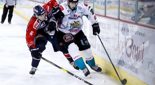 Belfast Giants' Kyle Baun with Medvescak Zagreb's Adam Deutsch during Thursday nights IIHF Continental Cup, Group E game at the SSE Arena, Belfast - Credit: William Cherry/Presseye