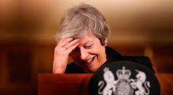 Britain's Prime Minister Theresa May enjoys a laugh during a press conference inside 10 Downing Street yesterday