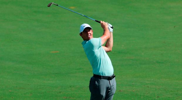 Focused: Rory McIlroy in first round action at the DP World Tour Championship in Dubai yesterday