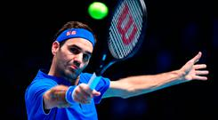 Fun group: Roger Federer eased into the semi-finals in London