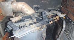 Guns were found in the boiler house of a Belfast home.