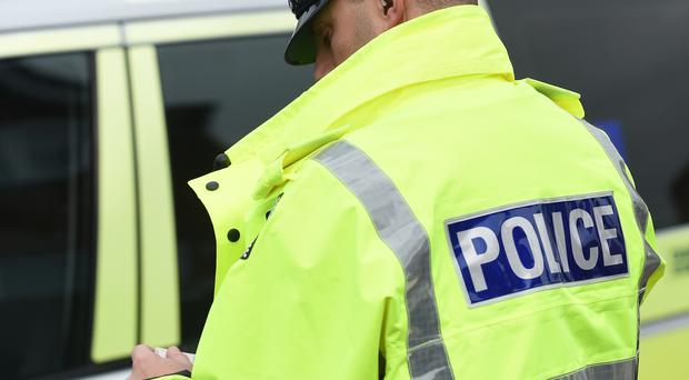 An investigation has been launched after police discovered racist graffiti daubed on a wall in Ballymena.