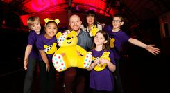 BBC Children in Need presenters Jo Scott and Barra Best with Jacob, Vaughn and Megan