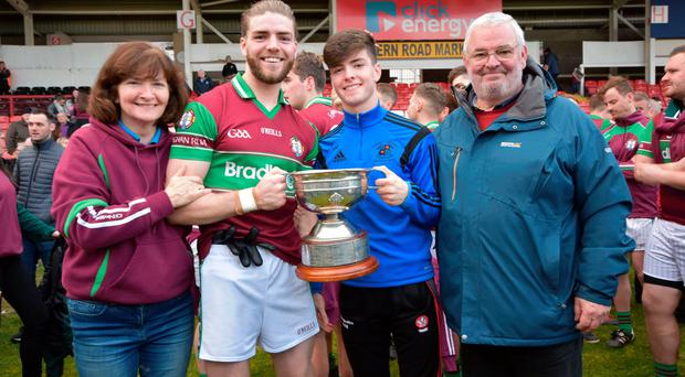 Family portrait: Ruairi Mooney with mum Rita, dad Hugh and brother Dara after the final of the Derry Championship
