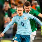 Captain's role: Steven Davis is pursued by Republic of Ireland's John Egan