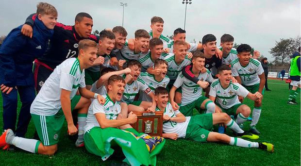Glory boys: Northern Ireland Schoolboys celebrate their Victory Shield triumph after overcoming Wales yesterday