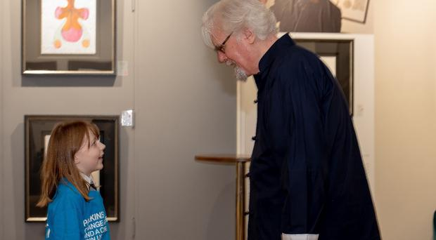 Primary pupil Abby McConnell was delighted to meet her hero, Sir Billy Connolly (Rosaleen Bonnar Photoworks/PA)