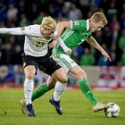 Northern Ireland's George Saville and Austria's Xaver Schlager in action during the Nations League qualifier in Belfast on November 18th 2018 (Photo by Kevin Scott for Belfast Telegraph )