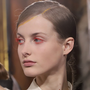 Eyes front: a model back stage at Dries Van Noten