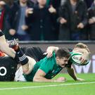 Over the line: Ireland's Jacob Stockdale scores the winning try against the All Blacks